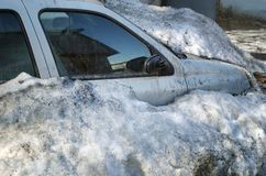 Dirty Car Under Snow Stock Images