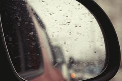 Dirty car wing mirror traffic bokeh background Stock Images