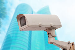 Dirty CCTV security camara with blurred office building backgrou Royalty Free Stock Photo