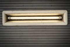 Dirty ceiling lighting in the entrance of the subway Landungsbr royalty free stock photography