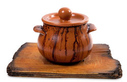 Dirty ceramic pot on old kitchen board Stock Image