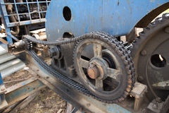 Dirty chain and cogwheel in transmission system Stock Photography