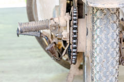 Dirty chain of old motorcycle. 's rear wheel royalty free stock photography