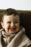 Dirty child laughing Stock Photo