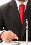 Dirty cigarette stumps versus clean electronic cigarette Royalty Free Stock Photography