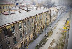 Dirty city streets and old dirty houses, sadness, poverty Royalty Free Stock Image