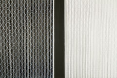 Dirty and Clean Air Filters. Close up side by side comparison of a dirty gray home air filter next to a clean white house furnace air filter Stock Photography