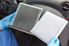 Dirty and clean cabin pollen air filter for a car stock image