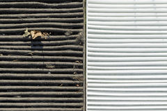 Dirty and clean. Half by half fragments of dirty and clean air filters Stock Photography