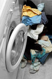 Dirty clothes. Washing machine and lot of dirty clothes Stock Images