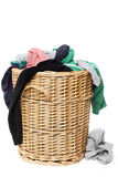 Dirty clothes laundry in wicker basket royalty free stock images