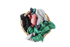 Dirty clothes laundry in wicker basket Royalty Free Stock Photos