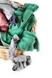 Dirty clothes loundry in wicker basket,. Dirty colored clothes in wicker basket ready for the laundry. Zenithal cut,  on white, close up Stock Images