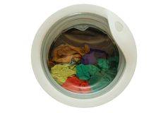Dirty clothes in washing machine. With open door royalty free stock image