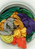 Spring cleaning - Dirty clothes in washing machine. Dirty clothes in washing machine with open door stock photo