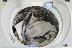 Dirty clothes in washing machine Royalty Free Stock Photo