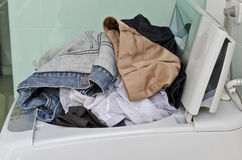 Dirty clothes in washing machine Royalty Free Stock Photography
