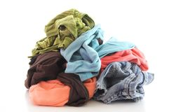 Dirty clothing. A pile of dirty clothing isolated on white background Royalty Free Stock Photos