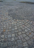 Dirty cobblestone road Royalty Free Stock Images