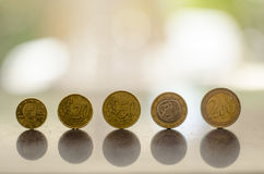 Dirty coins Stock Photo