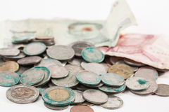 Dirty coins and old banknote Royalty Free Stock Images