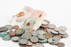 Dirty coins and old banknote Royalty Free Stock Image