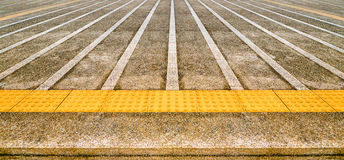 Dirty concrete pathway with Yellow tactile Stock Images