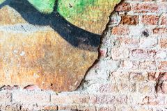 Dirty concrete wall with graffiti and big crack Stock Photos