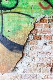 Dirty concrete wall with graffiti and big crack Royalty Free Stock Photo