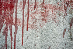 Dirty concrete wall with red paint splash. Dirty wall with stains of paint Stock Photo