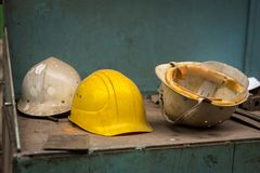 Dirty construction helmets Royalty Free Stock Images