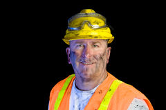 Dirty construction worker wearing hard hat Royalty Free Stock Image