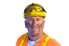 Dirty construction worker wearing hard hat Stock Image