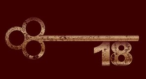 Dirty Copper 18 Key. An eighteenth birthday key in brass and grunge over brown Stock Photography