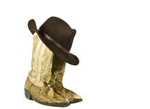 Dirty cowboy boots and hat isolated. On white Royalty Free Stock Image