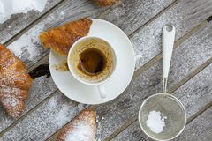 A dirty cup after coffee on a wooden surface. Stock Image