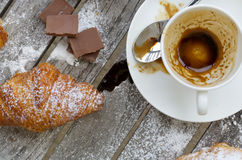 A dirty cup after coffee on a wooden surface. Royalty Free Stock Photography