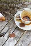 A dirty cup after coffee on a wooden surface. Royalty Free Stock Photo