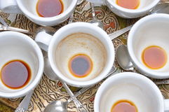 Dirty cups and spoons after coffee Stock Photo