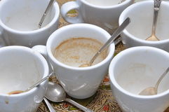 Dirty cups and spoons after coffee. On the table Royalty Free Stock Photography