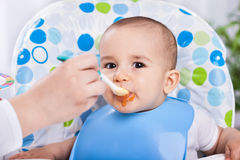 Dirty cute baby enjoy when eating food Royalty Free Stock Photography