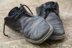 Dirty and damaged old shoes Stock Photo