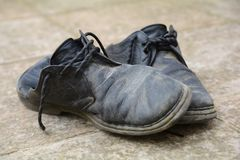 Dirty and damaged old shoes Stock Image