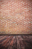 dirty dark brick wall and wooden floor Stock Photography
