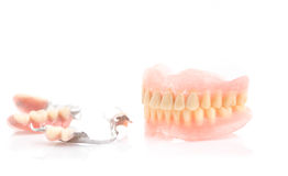 Dirty dentures,Tartar on full dentures and partial dentures on w Stock Photos