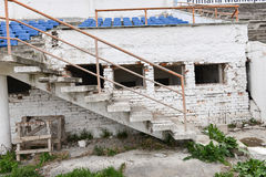 Dirty destroyed grandstands at stadium Stock Image