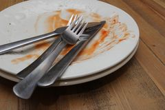 Dirty dinner plates and cutlery ready to be washed up Royalty Free Stock Photography