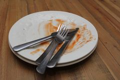 Dirty dinner plates and cutlery ready to be washed up Stock Photos
