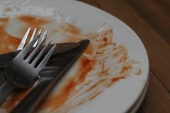Dirty dinner plates and cutlery ready to be washed up Royalty Free Stock Photo
