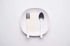 Dirty dish. White plate Top view on white background Royalty Free Stock Image